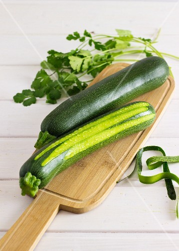 Two courgettes on a wooden board