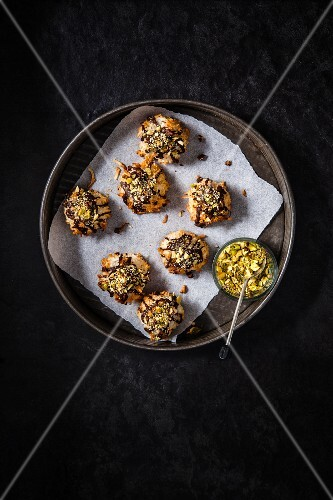 Coconut and pistachio macaroons on a metal tray