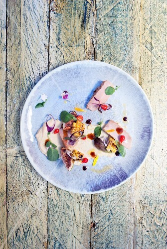 Tuna fish salad with chickpea cream and sweetcorn on a plate