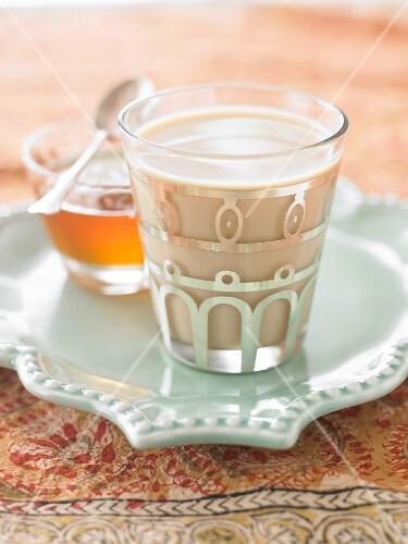 A glass of chai tea