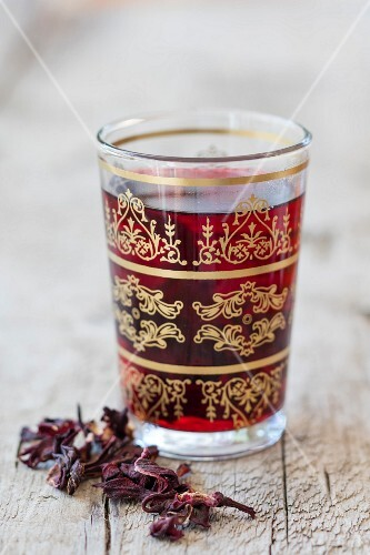 Hibiscus flower tea in an oriental tea glass