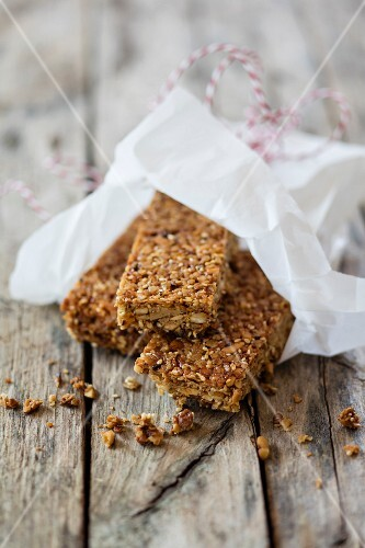 Gluten-free vegan muesli bars with nuts and lupine flakes