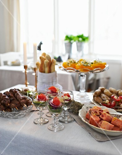An Easter buffet with pickled salmon, lamb kebabs, avocado and mozzarella cocktails and salt potatoes