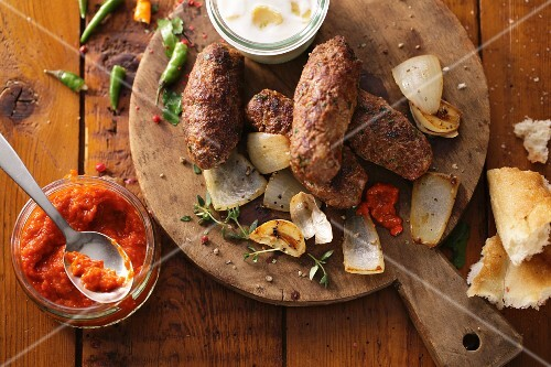 Cevapcici with ajvar (grilled minced meat sausages, Balkans)
