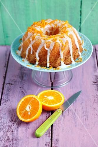 Orange cake with white icing and orange zest