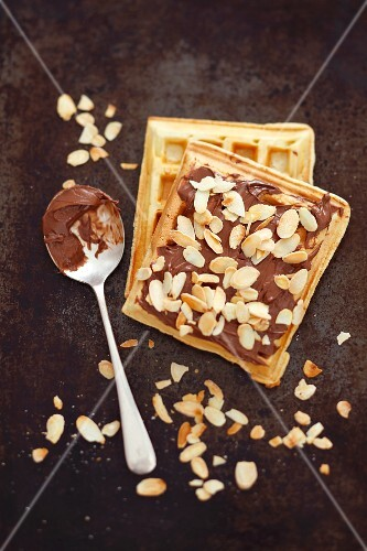 Waffles with chocolate cream and flaked almonds