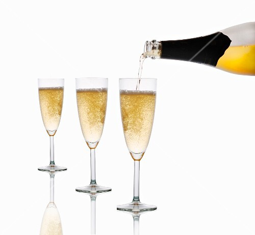 Sparkling wine being poured into glasses