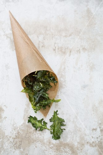 Kale crisps in a brown paper bag