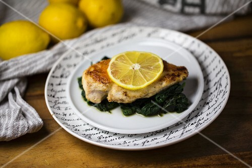Lemon chicken on a bed of spinach