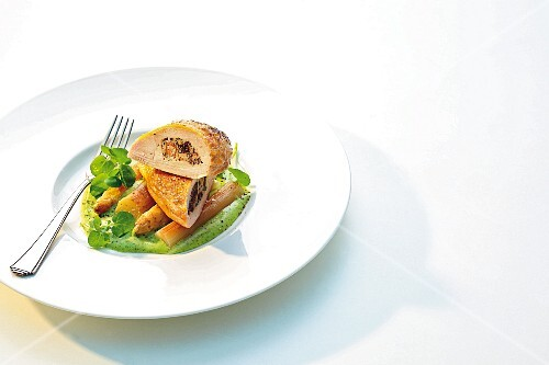 Corn-fed chicken breast filled with morel mushrooms on fried asparagus and watercress foam