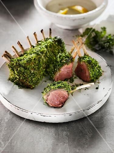 Rare rack of lamb in a herb coating
