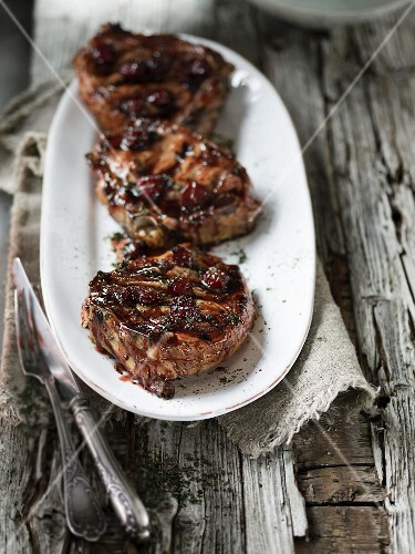 Grilled veal chops with a cherry marinade