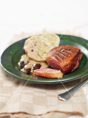 Duck breast with napkin dumplings and morel mushroom sauce