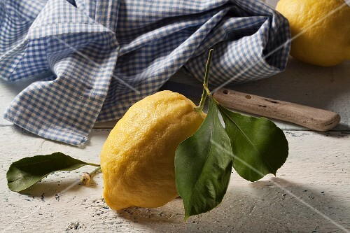 A fresh lemon with a leaf