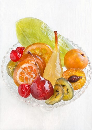 Various candied fruit on a glass plate