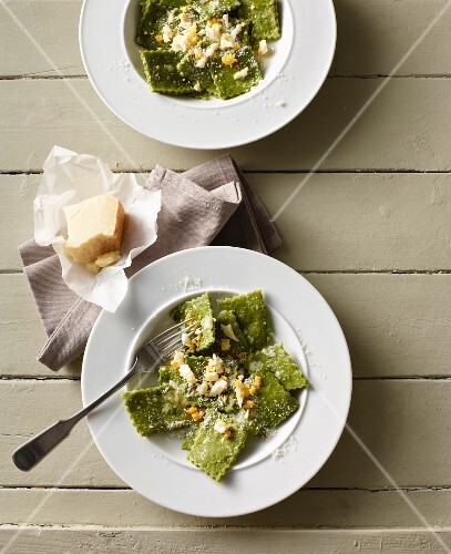 Herb Fleckerl (Austrian pasta) with butter, Parmesan cheese and chopped egg