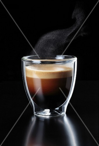 A glass of steaming espresso