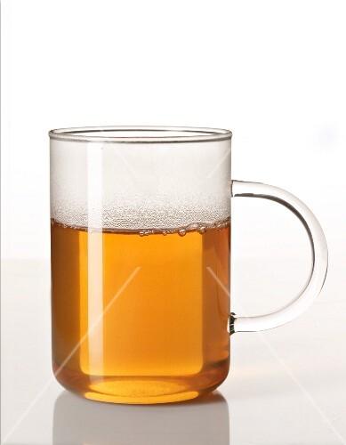 Hot tea in a glass cup