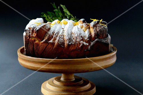Yeast cake with icing sugar and lemon zest
