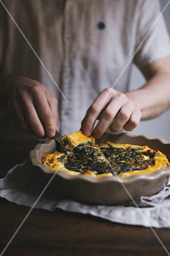 Spinach and feta cheese tart being sliced