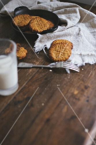 Freshly baked cookies and milk on a wooden table