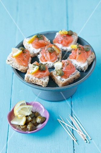 Mini canapes with smoked salmon and capers