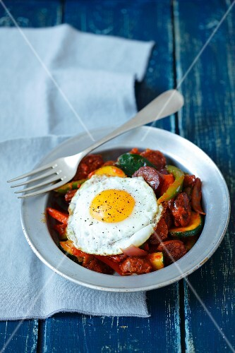 Fried chorizo with onions, peppers, courgettes and a fried egg