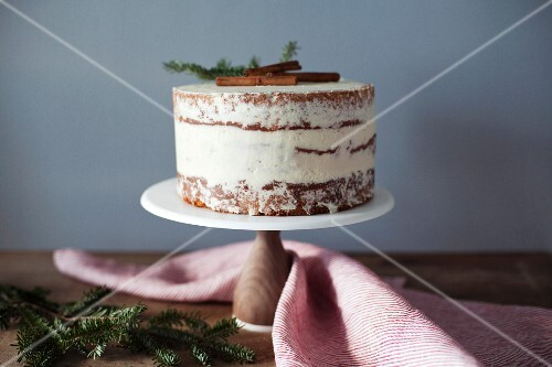 A winter eggnog cake on a cake stand
