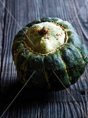 A pumpkin on a wooden surface