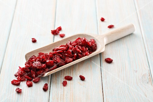 Dried cranberries on a wooden scoop