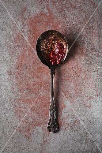 Strawberry compote on a silver spoon