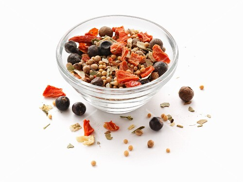 A mixture of preserved spices in a glass bowl
