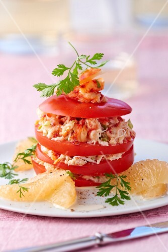 A tomato tower with grapefruit and crab meat