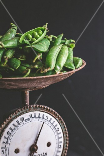 Fresh peas on old pair of kitchen scales