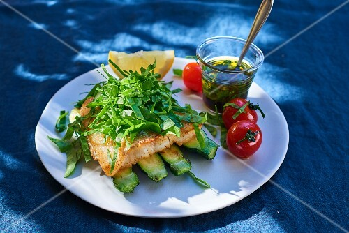 Cod on a bed of courgette with fresh herbs