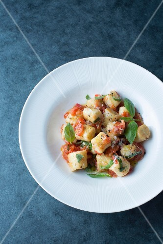 Ricotta gnocchi with tomatoes and basil
