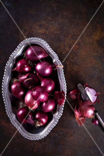 Red onions in a metal bowl