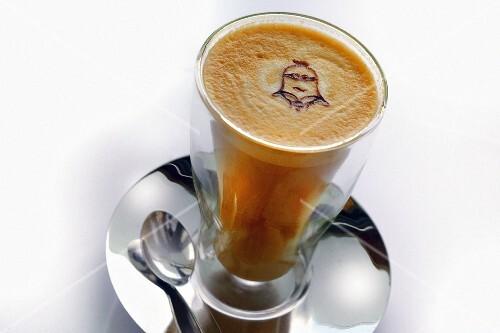 A glass of latte macchiato