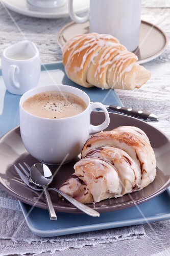 A sweet breakfast: croissants with icing and coffee