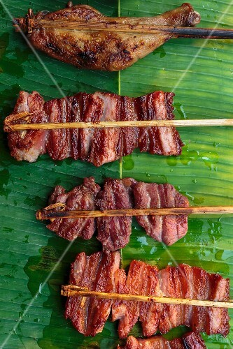 Pork and chicken skewers on a banana leaf, Luang Prabang, Laos