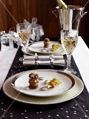 Black runner and white place settings on festive Christmas table
