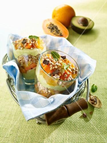 Muesli with avocado cream and papaya and orange confit