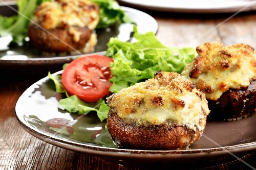 Stuffed mushrooms topped with melted cheese