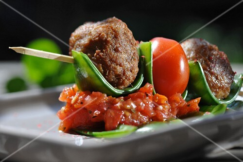 Meatballs with tomatoes on sticks