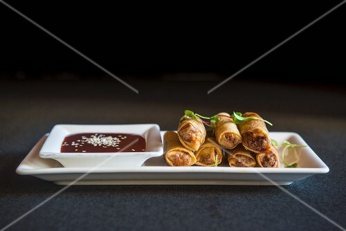 Spring rolls with duck and tamarind and sesame seed dipping sauce