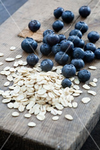 Blueberries and oats on a wooden board