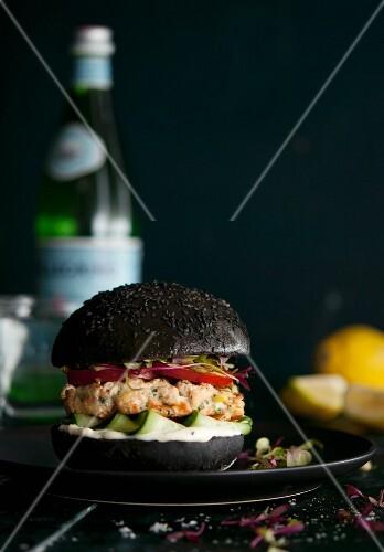 Salmon fillet on a black burger bun
