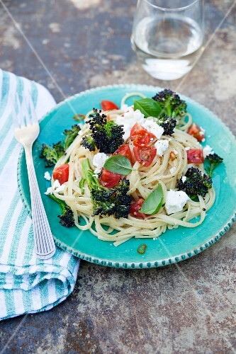 Linguine with purple broccoli, tomatoes, feta cheese, chilli and basil