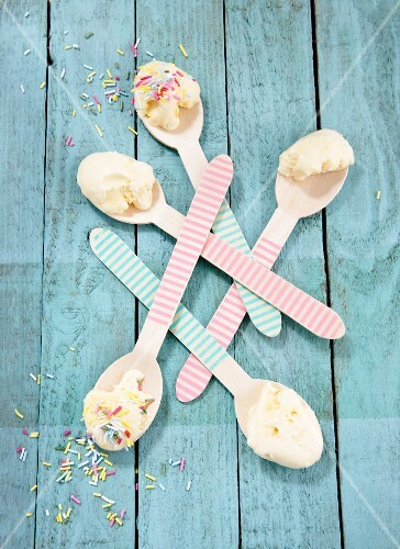 Ice cream and sugar sprinkles on striped spoons