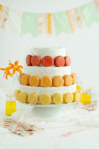 A festive, three-tier cake decorated with macaroons